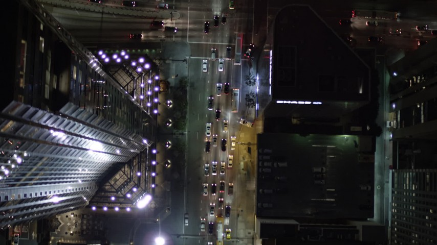 Bird's Eye of South Figueroa Street Traffic at Night in Downtown Los Angeles Aerial Stock Footage | AX0004_048
