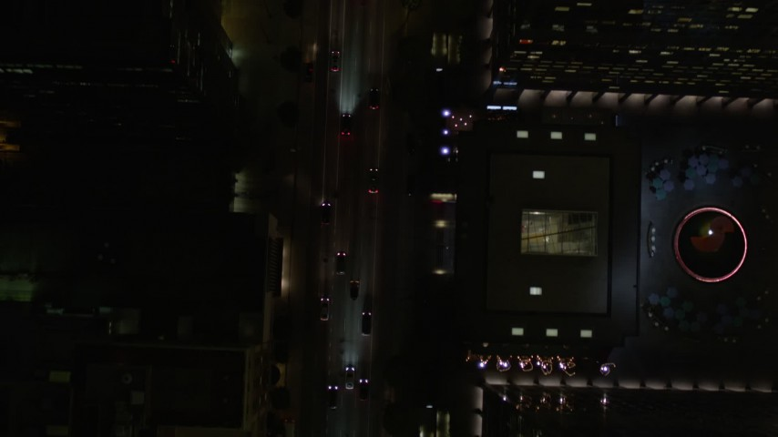 5K stock footage aerial video bird's eye of South Figueroa Street traffic at night in Downtown Los Angeles, California Aerial Stock Footage | AX0004_048E