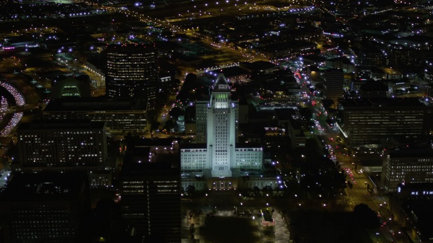 5K stock footage aerial video orbit of Los Angeles City Hall at night in Downtown Los Angeles, California Aerial Stock Footage | AX0004_051