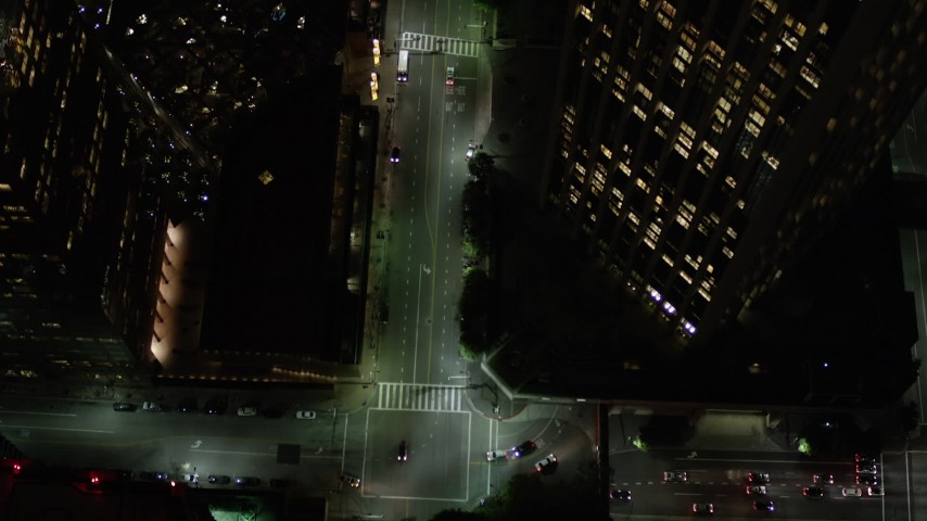 5K stock footage aerial video bird's eye view of South Hope Street in Downtown Los Angeles at night, California Aerial Stock Footage | AX0004_052