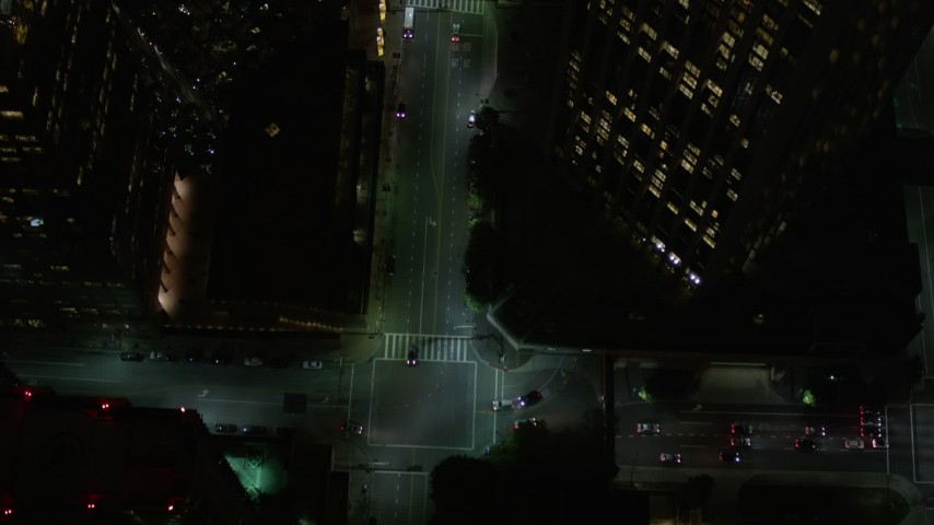 5K stock footage aerial video bird's eye view of South Hope Street in Downtown Los Angeles at night, California Aerial Stock Footage | AX0004_052E
