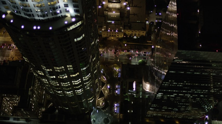 Bird's Eye of South Hope Street and Reveal Los Angeles Public Library at Night Aerial Stock Footage | AX0004_054