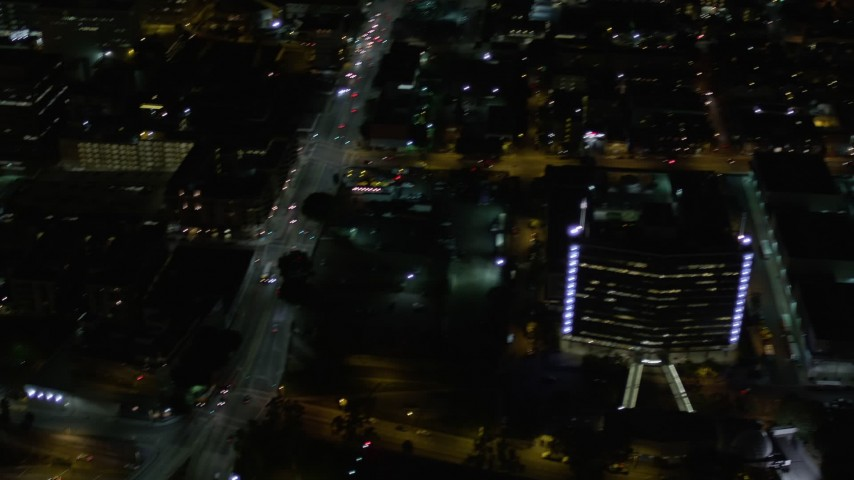 Pan Across Streets and Skyscrapers at Night in Downtown Los Angeles Aerial Stock Footage | AX0004_055