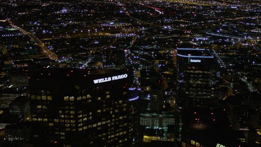 5K stock footage aerial video top of Wells Fargo Center at night in Downtown Los Angeles, California Aerial Stock Footage | AX0004_057