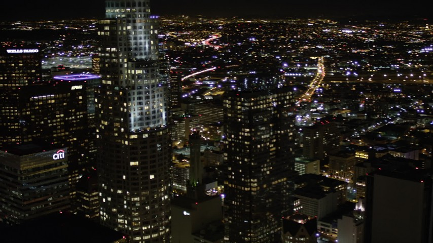 Pan Past Aon Center to Reveal US Bank Tower at Night in Downtown Los Angeles Aerial Stock Footage | AX0004_059
