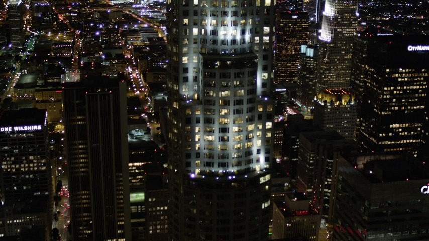 Pan and Approach US Bank Tower at Night in Downtown Los Angeles Aerial Stock Footage | AX0004_062