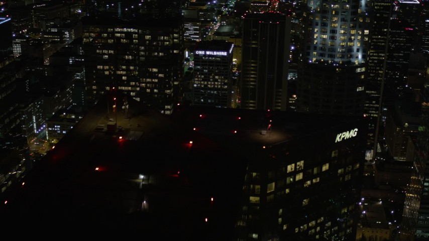 5K stock footage aerial video pan and approach US Bank Tower at night in Downtown Los Angeles, California Aerial Stock Footage | AX0004_062E