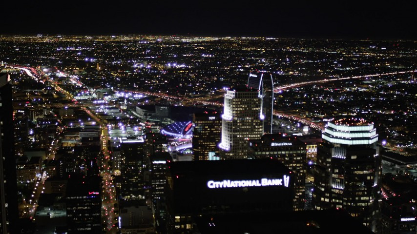 5K stock footage aerial video tilt and reverse from skyscrapers in Downtown Los Angeles at night, California Aerial Stock Footage | AX0004_063