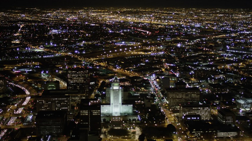 Approaching Los Angeles City Hall at Night in Downtown Aerial Stock Footage | AX0004_064