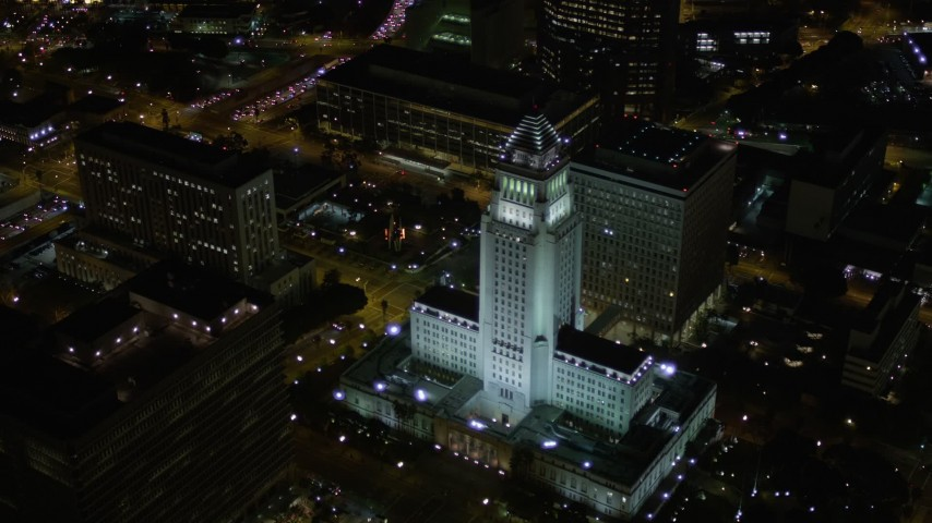 5K stock footage aerial video of approaching and orbiting Los Angeles City Hall at night in Downtown Los Angeles, California Aerial Stock Footage | AX0004_064E