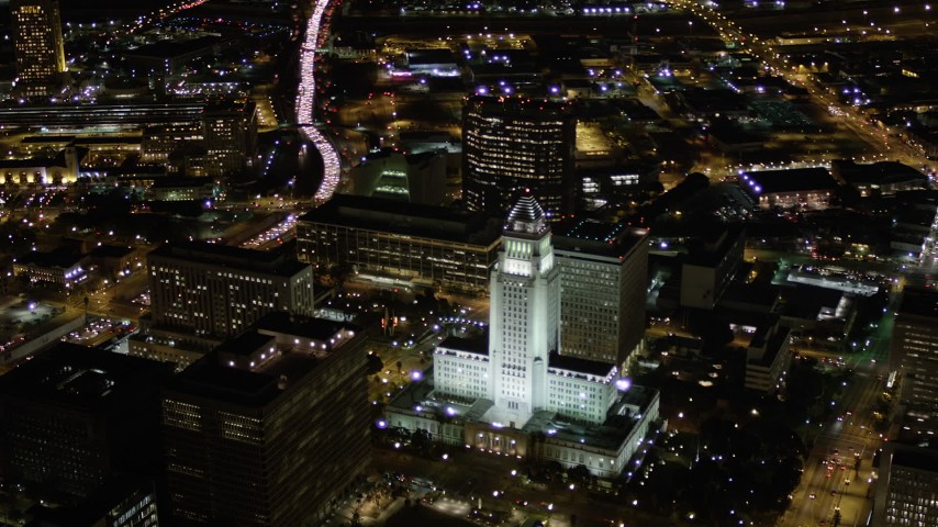 Approach Los Angeles City Hall at Nighttime in Downtown Los Angeles Aerial Stock Footage | AX0004_065