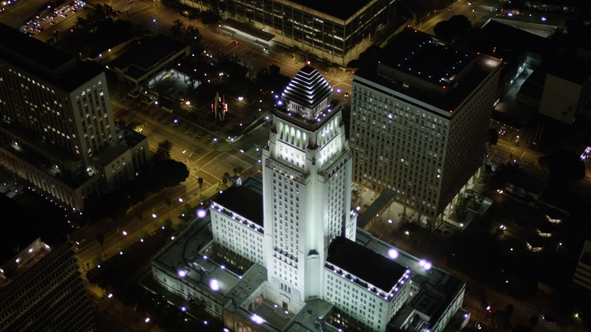 5K stock footage aerial video tilt to bird's eye view of Los Angeles City Hall at night, California Aerial Stock Footage | AX0004_066