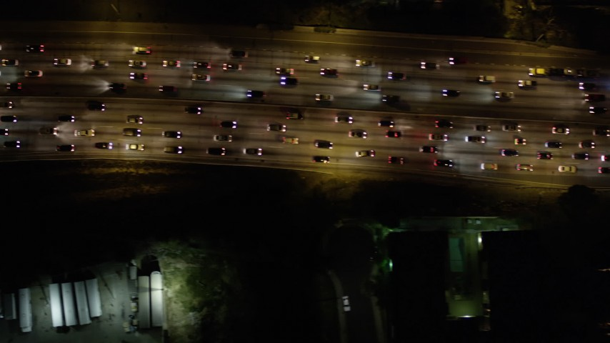 Bird's Eye View of Heavy Freeway Traffic at Night in Hollywood, California Aerial Stock Footage | AX0004_069