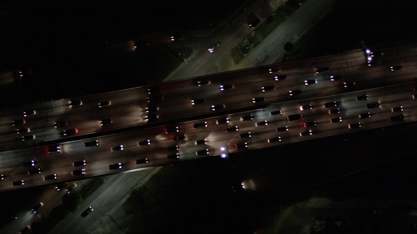Bird's Eye View of Heavy Traffic on Highway 101 at Night in Hollywood Aerial Stock Footage | AX0004_070
