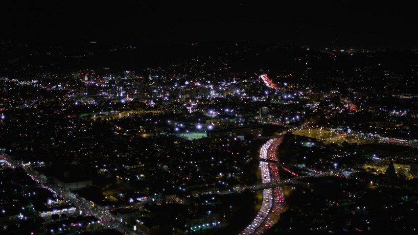 5K stock footage aerial video follow Highway 101 with rush hour traffic and approach Hollywood at night, California Aerial Stock Footage | AX0004_071