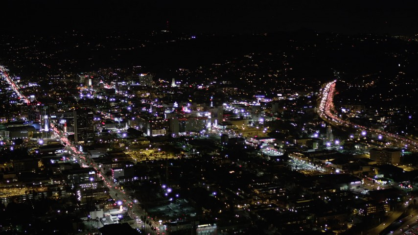 Orbit Buildings Between Sunset and Hollywood Boulevard at Night  Aerial Stock Footage | AX0004_072