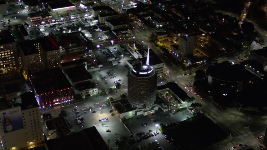 Orbiting Capitol Records Building at Night in Hollywood, California Aerial Stock Footage | AX0004_075