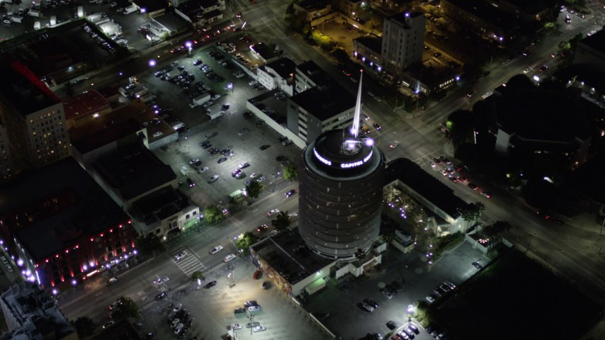 5K stock footage aerial video orbiting Capitol Records Building at night in Hollywood, California Aerial Stock Footage | AX0004_075