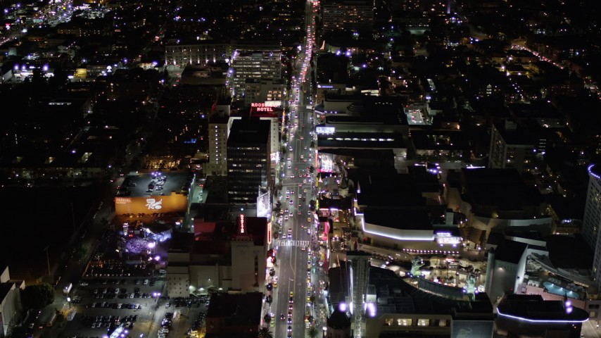 Tilt Down to a Bird's Eye View of Hollywood Boulevard and Hollywood and Highland Center at Night Aerial Stock Footage | AX0004_077