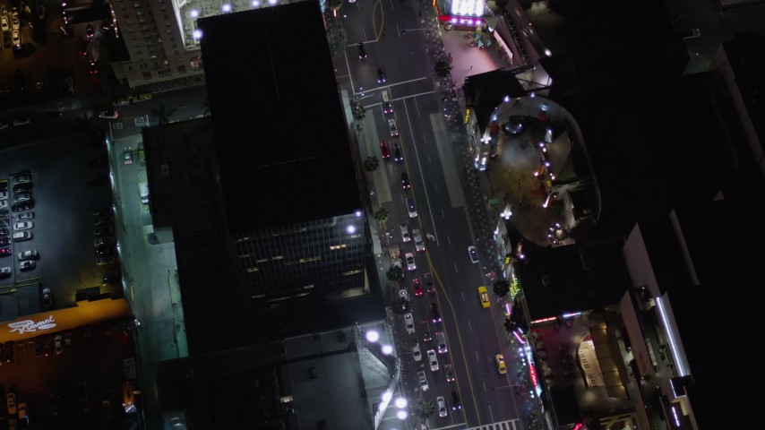 Bird's Eye Orbit of Grauman's Chinese Theater at Night on Hollywood Boulevard Aerial Stock Footage | AX0004_078