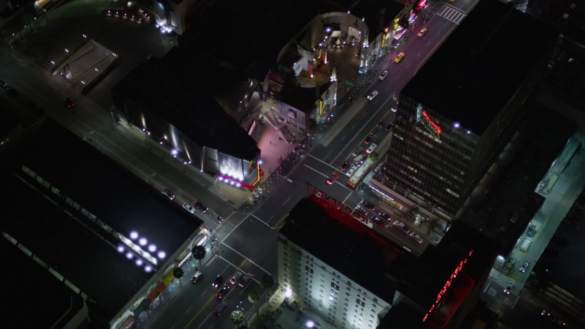 Reverse View of Grauman's Chinese Theater on Hollywood Boulevard at Night Aerial Stock Footage | AX0004_079