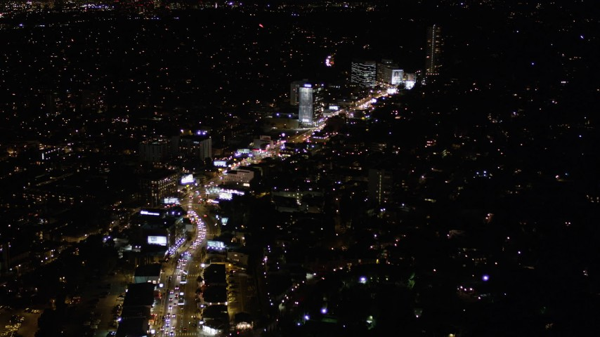 5K stock footage aerial video fly over Sunset Boulevard and Sunset Strip at night in West Hollywood, California Aerial Stock Footage | AX0004_083