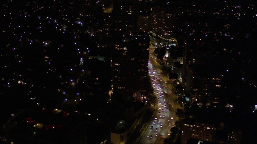 Following Wilshire Boulevard through Westwood at Night Aerial Stock Footage | AX0004_087