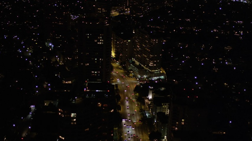 5K stock footage aerial video of following Wilshire Boulevard through Westwood at night, California Aerial Stock Footage   AX0004_087