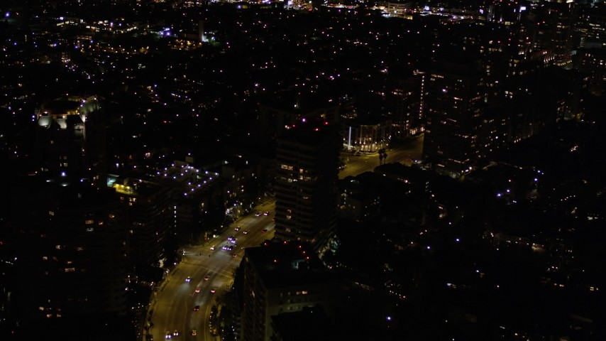 Flying Over Wilshire Boulevard through Westwood at Night Aerial Stock Footage | AX0004_088