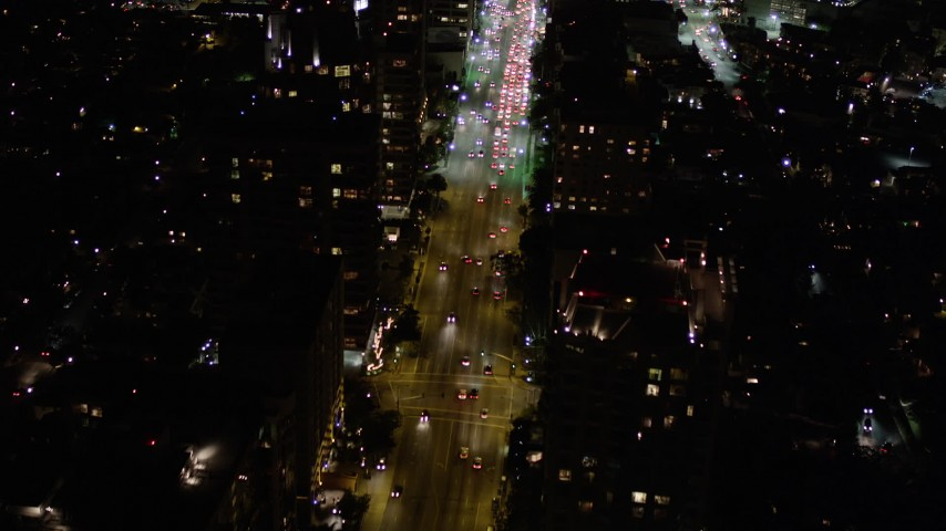 Fly Over Nighttime Traffic on Wilshire Boulevard in Westwood Aerial Stock Footage | AX0004_089