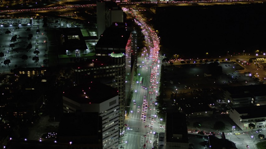 5K stock footage aerial video fly over and tilt to traffic on Wilshire Boulevard at night, California Aerial Stock Footage   AX0004_090