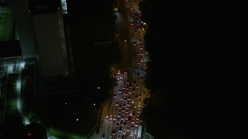 Bird's Eye View of Wilshire Boulevard and Reveal Interstate 405 at Night Aerial Stock Footage | AX0004_091