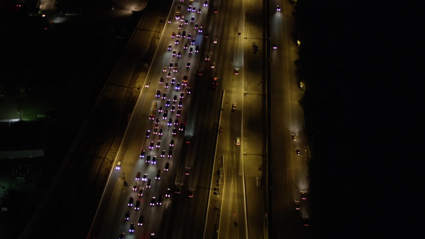 Fly Over Traffic on Interstate 405 by Westwood at Night Aerial Stock Footage | AX0004_092