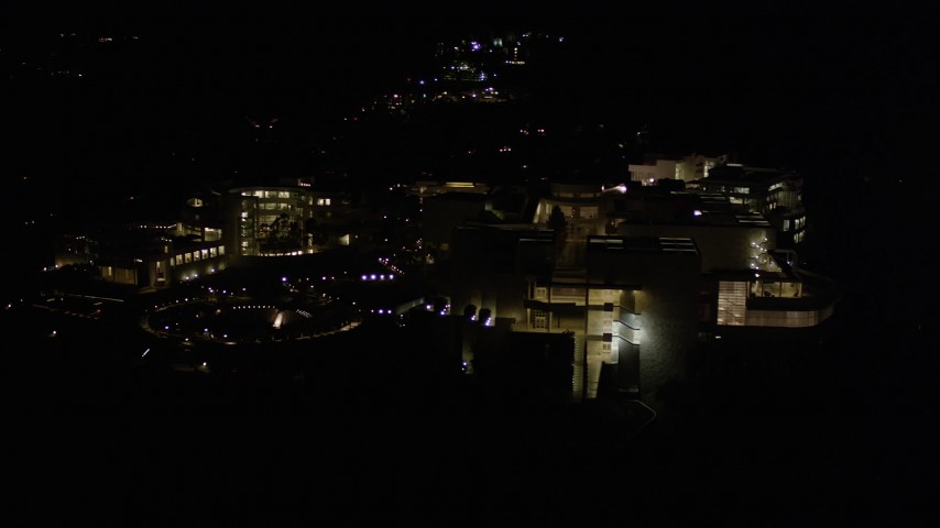 5K stock footage aerial video orbiting the J. Paul Getty Museum at night in Brentwood, California Aerial Stock Footage | AX0004_097