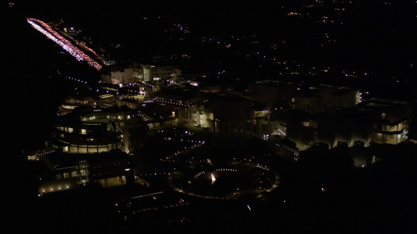 5K stock footage aerial video orbit around the J. Paul Getty Museum in Brentwood at night, California Aerial Stock Footage | AX0004_098