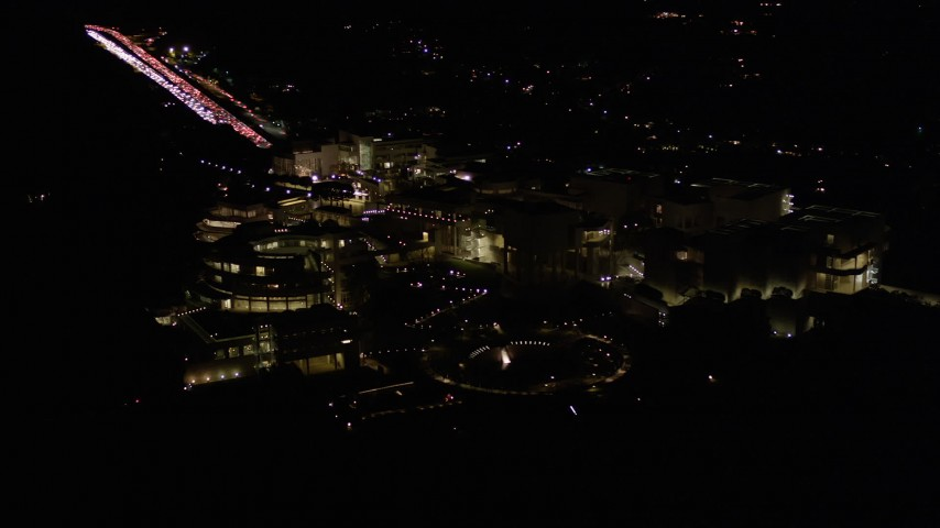 5K stock footage aerial video tilt and reveal the J. Paul Getty Museum at night in Brentwood, California Aerial Stock Footage | AX0004_099