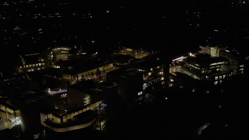 5K stock footage aerial video of close orbit of the J. Paul Getty Museum at night in California Aerial Stock Footage | AX0004_101