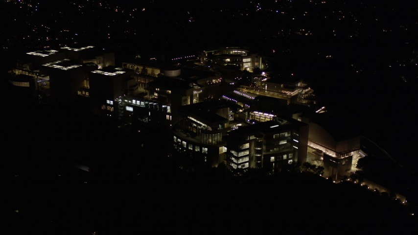5K stock footage aerial video of a reverse view of the J. Paul Getty Museum at night in Brentwood, California Aerial Stock Footage | AX0004_102
