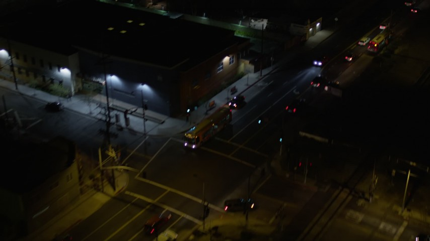 Reverse View of a City Street at Night in Pacoima, California Aerial Stock Footage | AX0004_104
