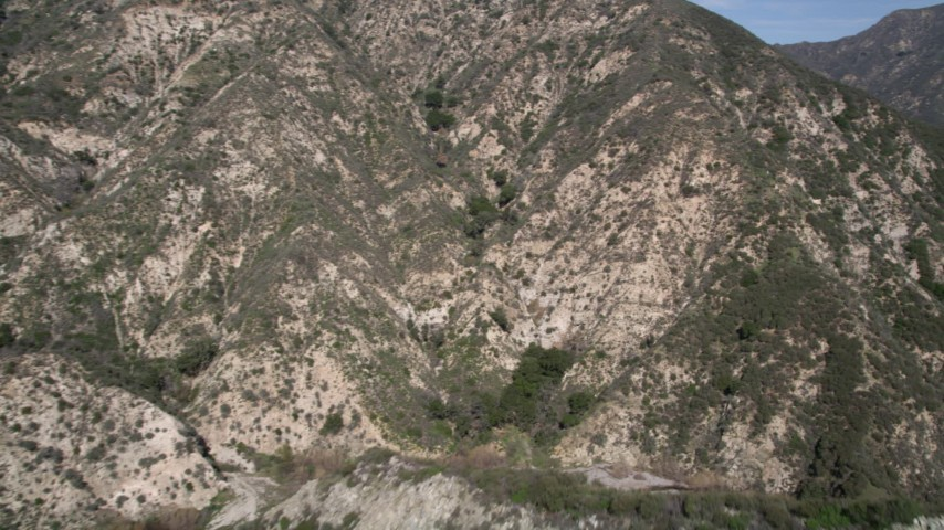 5K aerial video of flying through canyon in the San Gabriel Mountains of California Aerial Stock Footage | AX0005_003