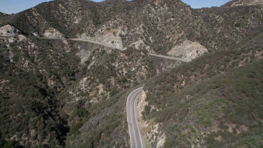 5K stock footage aerial video of following Little Tujunga Canyon Road through San Gabriel Mountains, California Aerial Stock Footage | AX0005_006