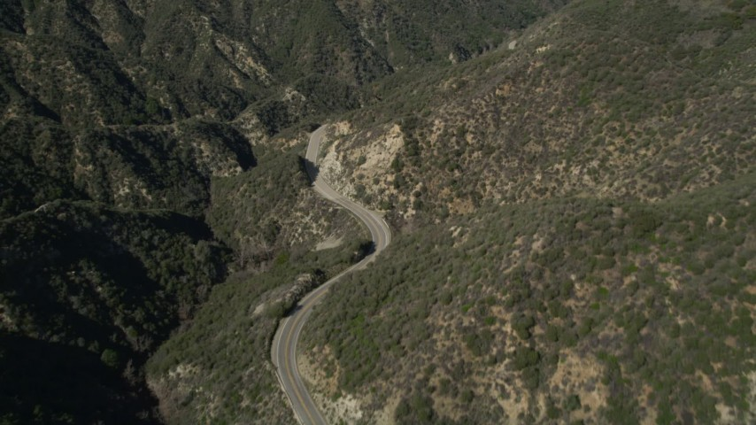 5K stock footage aerial video follow a winding road through San Gabriel Mountains, California Aerial Stock Footage | AX0005_008
