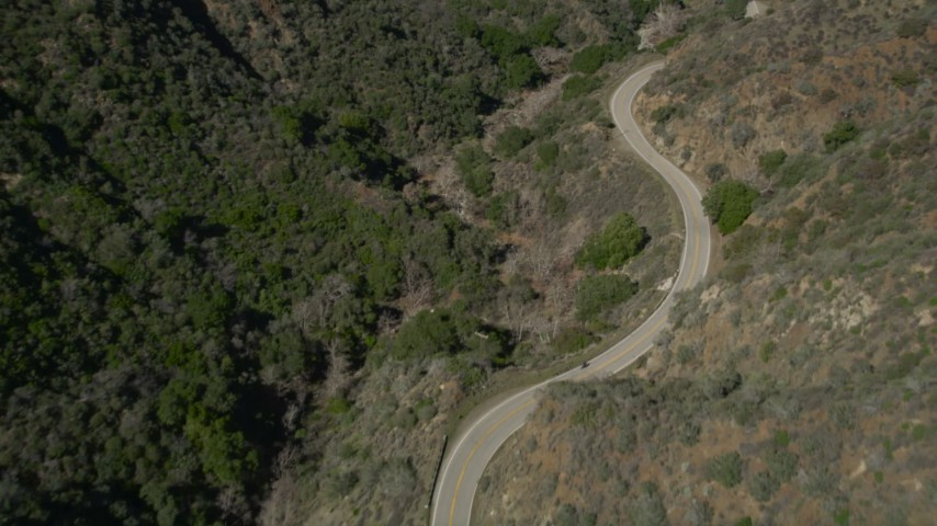 5K stock footage aerial video follow mountain road through San Gabriel Mountains in California Aerial Stock Footage | AX0005_009