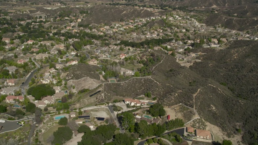 5K stock footage aerial video fly over suburban neighborhoods in Santa Clarita, California Aerial Stock Footage | AX0005_010