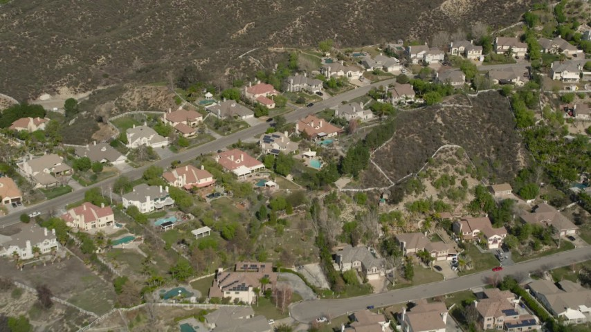 5K stock footage aerial video fly over suburban tract homes in Santa Clarita, California Aerial Stock Footage | AX0005_011