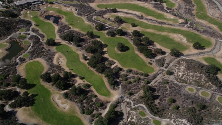 5K stock footage aerial video of orbiting green golf course lawns in Canyon Country, California Aerial Stock Footage AX0005_013 | Axiom Images