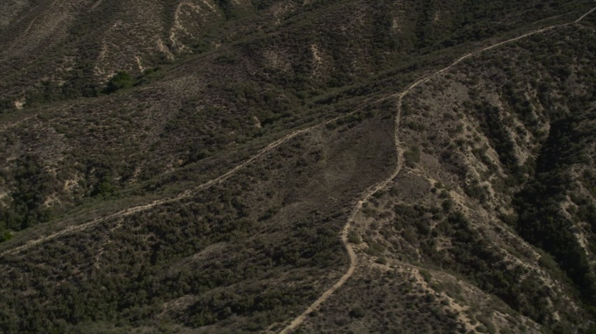 5K stock footage aerial video of orbiting dirt roads up ridges in the San Gabriel Mountains, California Aerial Stock Footage | AX0005_015