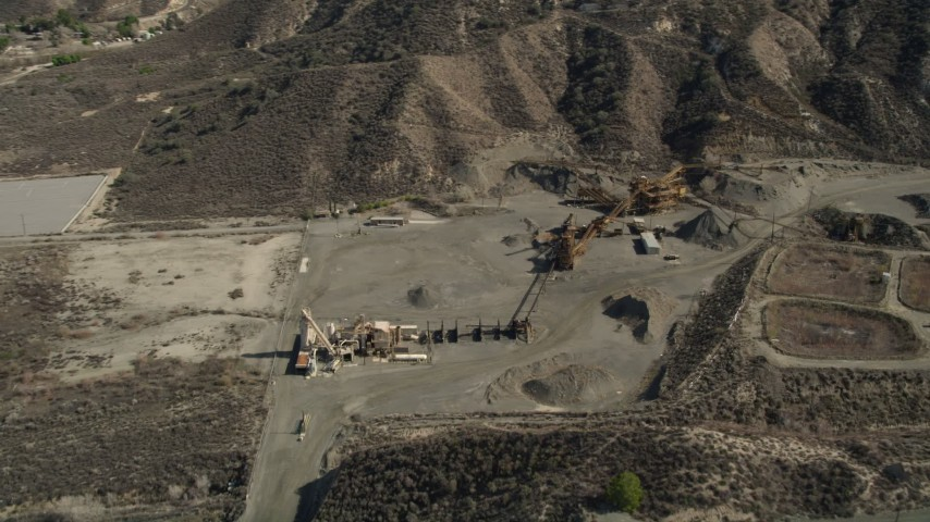 5K aerial stock footage video of equipment at a quarry in Canyon Country, California Aerial Stock Footage | AX0005_016