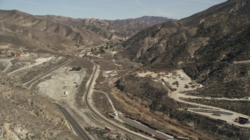 5K stock footage aerial video follow road to a tunnel through mountain in the San Gabriel Mountains, California  Aerial Stock Footage | AX0005_018