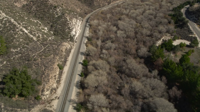 5K stock footage aerial video of a railroad track through Santa Clarita Countryside in California Aerial Stock Footage | AX0005_022